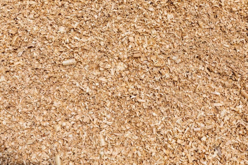Sawdust or wood dust texture background.